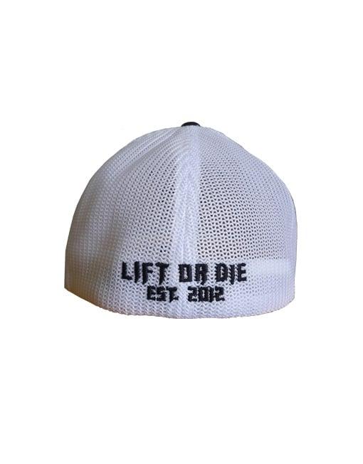 casquette sport homme noir et blanche flexfit